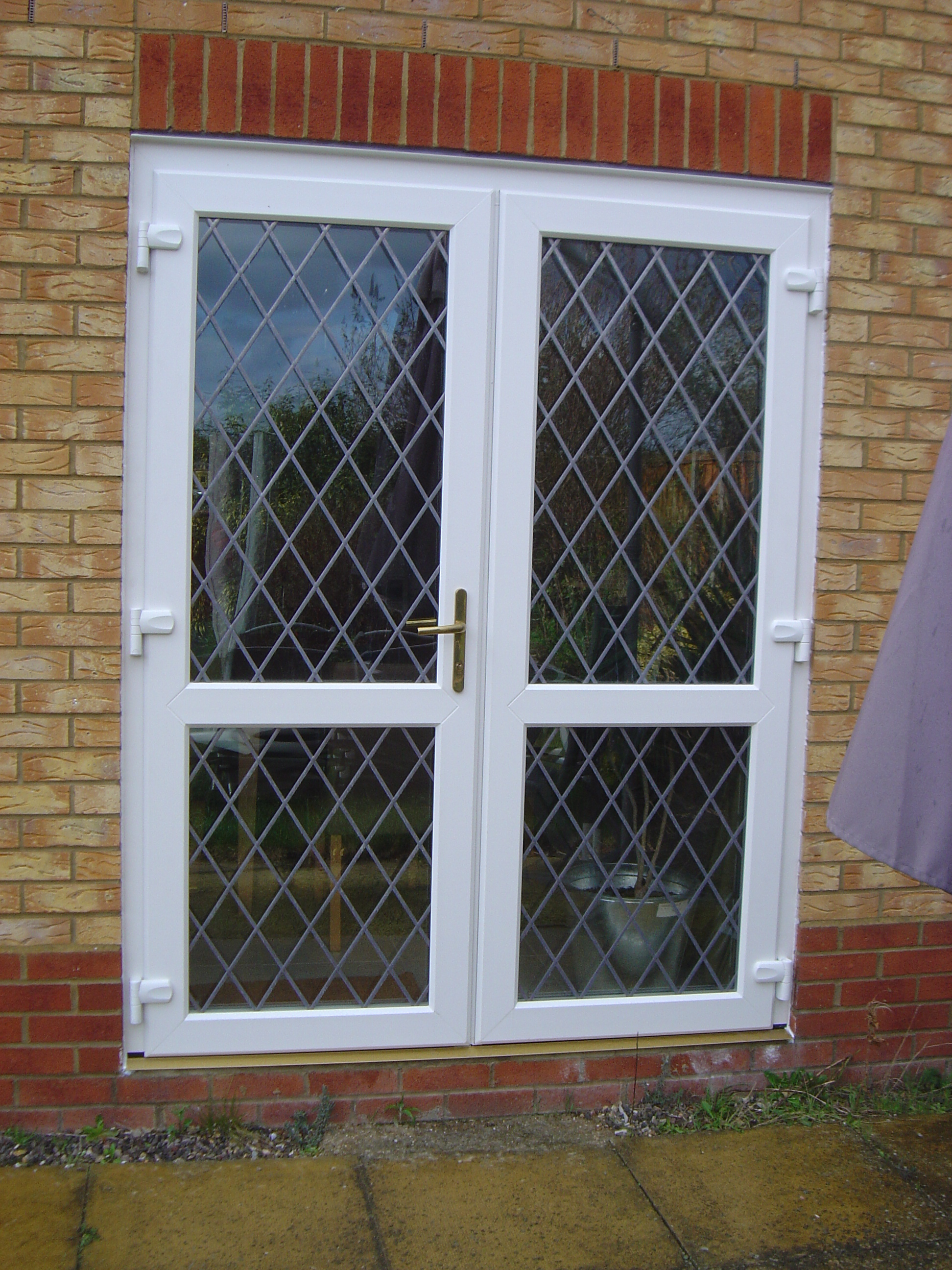 Door security door security for outward opening doors for Outward opening french doors